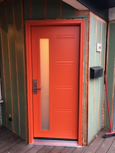 steel-door-installation-replacement-toronto-orange-with-offset-window